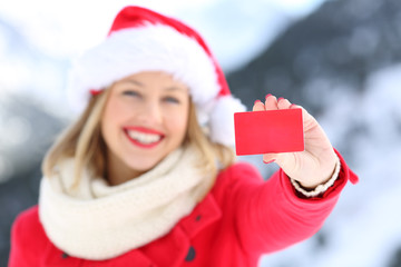 Woman showing credit card in christmas holidays