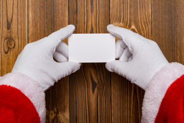 Santa Claus holding a white blank card good for test