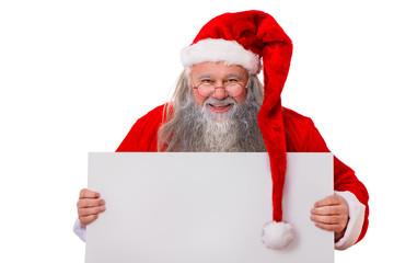 Weihnachtsmann hält Schild in den Händen