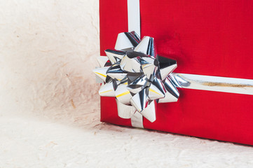 Red gift with silver ribbon and bow