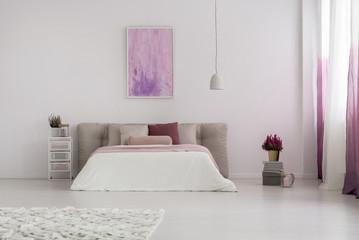 Pink painting in spacious bedroom