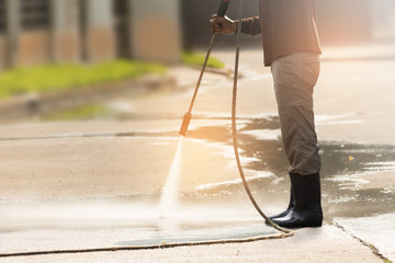 High pressure deep cleaning.Worker cleaning driveway with gasoline high pressure washer ,professional cleaning services. Fototapete