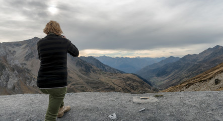 woman photograph the col of Tourmalet in the Pyrenees