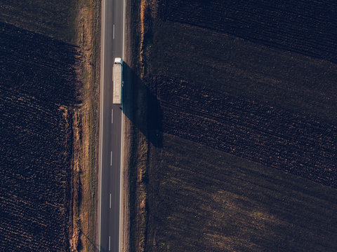 Aerial view of freight transportation truck on the road