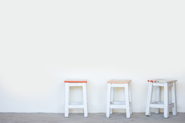 wooden chair,three chair on white background,The wooden chair was placed in the corner.