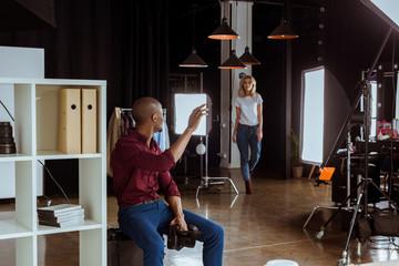 african american photographer greeting caucasian model before photoshoot in studio