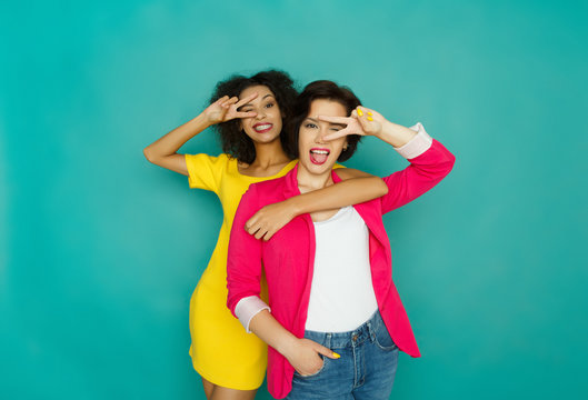 Two girlfriends having fun at azur studio background
