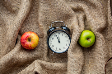 Apples and alarm clock