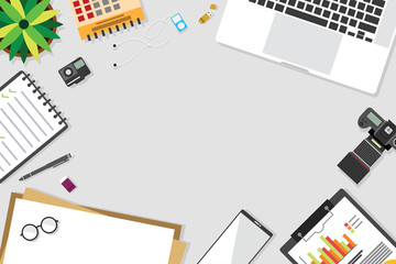 Top view of table working and working desk with gadget and free space for text with accessory on the table, laptop, notebook, desktop, phone, flash drive, coffee cup, letter, flowerpot, note, camera,