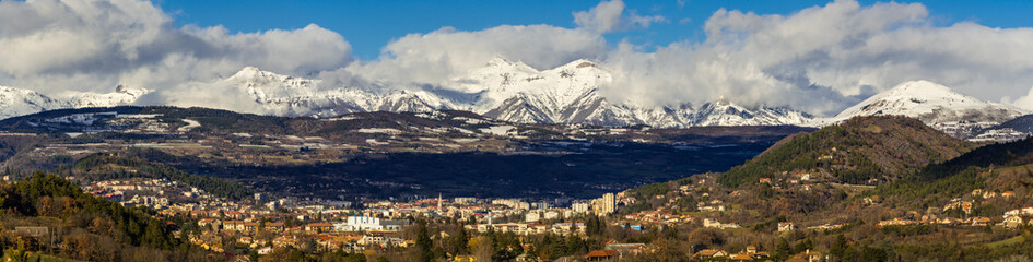 Winter panoramic view of the City of Gap, its basin and in the distance, the mountain peaks of the Ecrins National Park. Hautes-Alpes, Southern French Alps, France