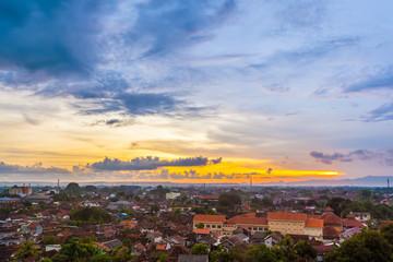 City landscape, top view, against the sunset. Yogyakarta, Jawa, Indonesia.