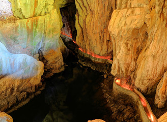 Labyrinthine, illuminated walkways and reflective pool inside Skocjan Caves, one of UNESCO's natural and cultural world heritage sites