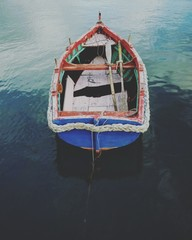 Colorful fisher luzzu boat on water