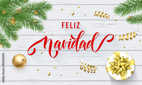Feliz navidad spanish merry christmas holiday golden decoration and feliz navidad spanish merry christmas holiday golden decoration and calligraphy font for greeting card white wooden m4hsunfo