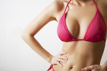 sexy slim woman in pink bikini