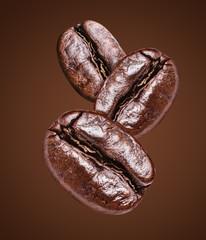 Three roasted coffee beans.