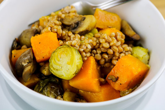 A healthy vegetable bowl with Brussels sprouts, butternut squash, mushrooms and hard red wheat