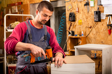 Man builds furniture in the carpentry shop