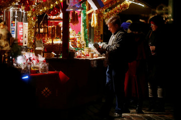 People shop at the Christmas market in Tallinn