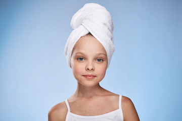 little girl in a towel on a light background