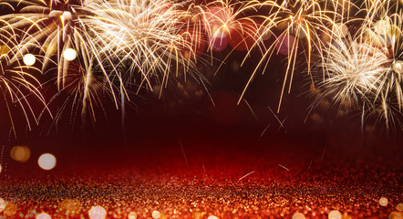 Fototapete - Gold Fireworks and red bokeh in New Year eve and copy space. Abstract background holiday.