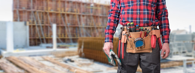 Building worker with tool belt