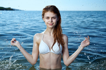 beautiful girl with red hair in the sea