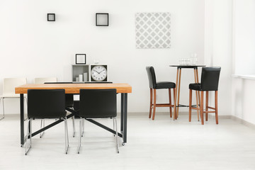 Modern room interior with big table and chairs
