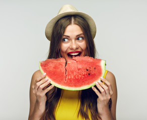 Woman eating watermelon. Studio isolated