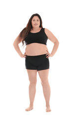 Overweight woman in underwear on white background