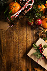 Christmas background with oranges, candy canes and decorations