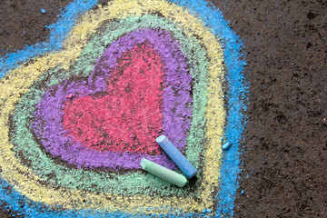 chalk drawing: colorful hearts on asphalt