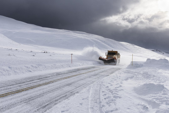 Snow Plow Clearing Roads during Snowstorm