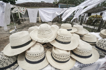 Handmade straw hats as a background