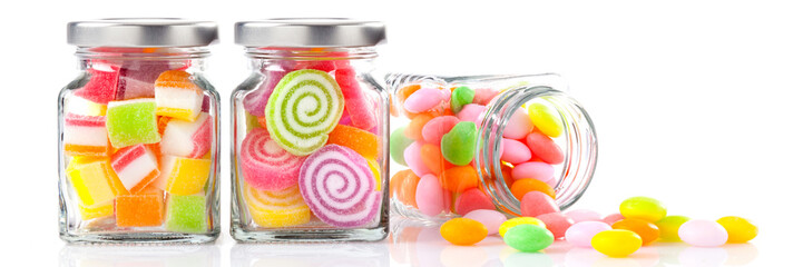 Canvas Prints Candy colorful candies in glass jars on white background - Web banner with food concept