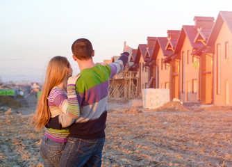 loving couple looking at their home.