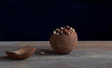 Walnut coconut hazelnuts on an old table.