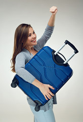 Smiling woman ready for travel looking happy