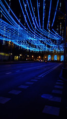 Christmas lights decoration in the city ishining in the night
