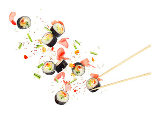 Pieces of sushi fly in the air on a white background