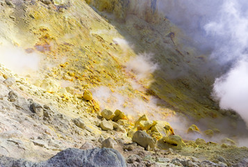 Wall Mural - Inside active volcano crater smoking hot ash sulfur mountain .