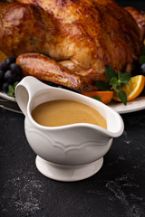 Homemade gravy in a sauce dish with turkey