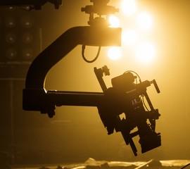 Film camera on crane , background of lighting set up