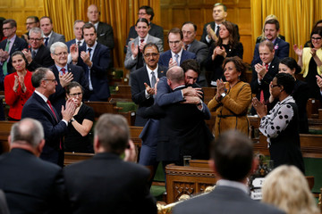 Canada's PM Trudeau hugs Liberal MP Boissonnault after delivering an apology to members of the LGBT community on Parliament Hill in Ottawa