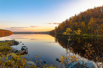 Autumn landscape.Lake in the autumn forest at sunset
