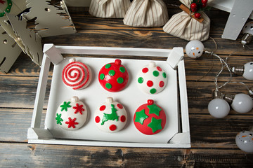 Cupcakes on christmas decorated wooden table