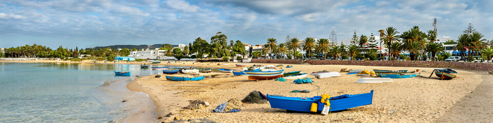 Photo sur Toile Tunisie Wooden boats on the Mediterranean coast in Hammamet, Tunisia