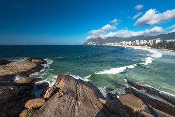 Scenic panoramic view of Ipanema Beach from the rocks at Arpoador with Rio de Janeiro skyline Brazil