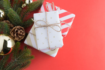 christmas gift presents in decorative boxes on red
