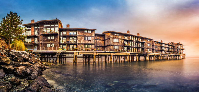 Panorama with stilt houses in West Seattle neighborhood at sunset``